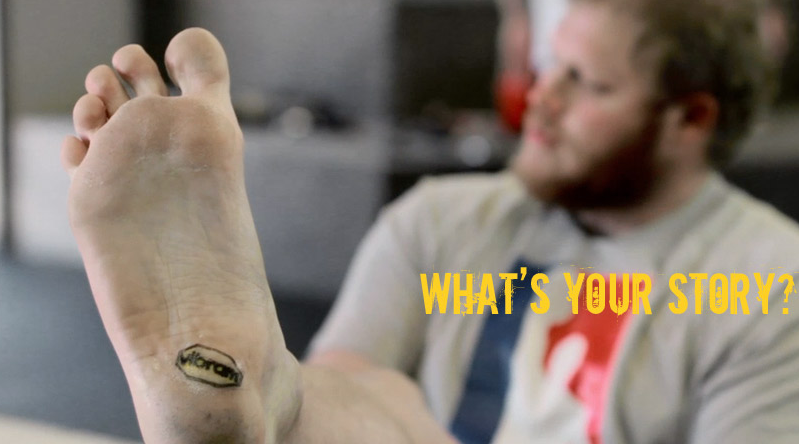 Adam Downing Tattoos Vibram Logo on his foot