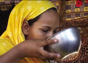 Hima woman tradition of drinking milk to gain weight.