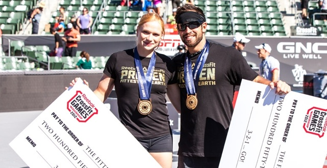 Annie Thorisdottir and Rich Froning with their 2012 CrossFit Games Winners Checks